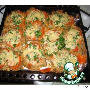 Свинина, запеченная с помидорами и сыром