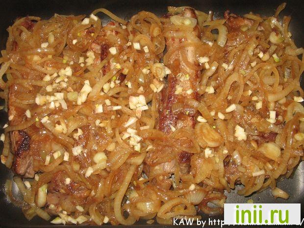 Свиные ребрышки в медово соевом соусе.